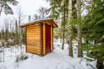 The cute little outhouse is located a few feet back from the bunkhouse and great for bunkhouse guests to use if they don`t want to make the walk to the main house.