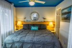 Look up at the blue sky AKA the ceiling as you drift off to sleep in the coastal cottage themed bedroom.
