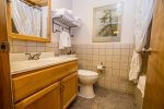 The bathroom features a large vanity for getting ready in the morning before your North Shore adventures.
