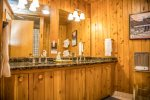 The fully renovated bathroom features granite topped dual sinks.