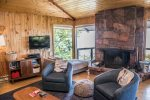 With commanding 180 degree views of Lake Superior, your stay is enhanced with a massive natural stone fireplace.