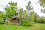 This vacation rental home is located on a peaceful, tree filled lot on the Caribou Trail.