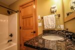 The second bathroom features a shower/tub combo is located on the upper level, in between both bedrooms.