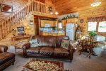 Lutsen Log Lodge 14 is a 3 bedroom, 2 bathroom log cabin home in Lutsen, MN.The living room opens into the kitchen and dining room area.