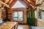 Large windows allow plenty of natural light - great for a cabin with no electricity.