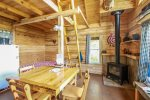The gas wood stove fireplace is the only source of heat in this cabin while lending a beautiful focal point.