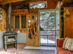 The cozy cabin has a wood stove as its primary heat source.