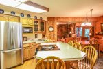 The kitchen is large and well-equipped, perfect for preparing a home cooked meal during your stay.
