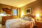 Two of the three bedrooms in this home have queen beds.