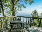 The home`s deck is a guest favorite with seasonal seating, a grill, and great Lake Superior views.