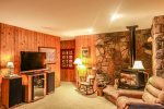 The large flat screen TV and entertainment area are perfect for rainy North Shore days.