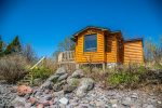 Creekside Cabin on Lake Superior is perfect for a solo trip or a cozy getaway for two.