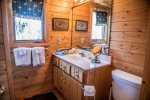 The cabin`s bathroom features a walk-in shower.