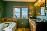 The attached master bathroom has a deep jetted tub and even more Lake Superior views.
