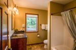 The shower/tub combo in the second upper level bathroom is great for your guests.