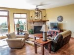 Enjoy the gas fireplace and incredible Lake Superior views in the living room area.
