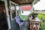 Grab a seat on the front porch and greet locals and tourists alike in this neighborhood home.