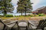 Enjoy relaxing on the ground level patio that leaves you just steps away from the Grand Marais Harbor.