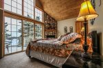 This master bedroom offers a private balcony , gas fireplace, t.v. and queen bed.