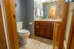 The attached guest bathroom provides plenty of privacy for all guests.