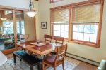 Grab your meal at the kitchen table- situated in front of the lake-facing windows.