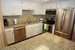 Stainless steel appliances and granite countertops in the kitchen, so nice.