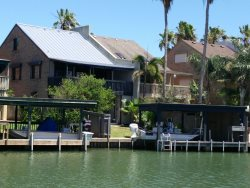 Enchanted Bay Luxury waterfront rental with boat slip and dock