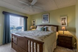 King size master bedroom - open the door to listen to the waves outside.