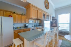 Kitchen with Island and Bar area - South Padre Island Beach House Rental