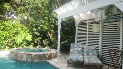 Relax in the comfort of your own private and tropical backyard after a fun day at the beach.