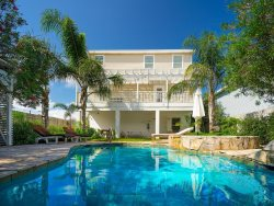 HIBISCUS VILLA  Book Now! 281- 222- 0432 Luxury Villa, charming coastal style, 20 FT long private tropical pool and hot tub totally outfitted 3 MIN.WALK TO BEACH 119 E Gardenia