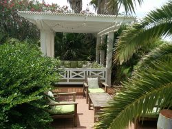 Outdoor Lounge and sunning deck. Lotus Villa Luxury 4 story Vacation Rental at the Shores South Padre Island