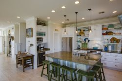 Kitchen and breakfast bar. Lotus Villa Luxury 4 story Vacation Rental at the Shores South Padre Island