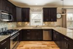 Granite counters and stainless appliances for your master chef