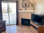 Fire Place, TV and walk out balcony with BBQ