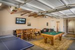 The garage has been converted into a game room offering a pool table, ping pong table, Foosball & a large flat screen TV for entertainment.