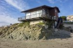 This iconic oceanfront cayucos beach home sits directly over the sand offering direct beach access and stunning views