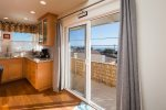 Sneak out the sliding glass door onto the balcony to enjoy ocean views with your morning coffee