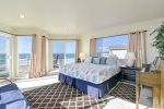 The gorgeous master bedroom is upstairs with a king bed and stunning views