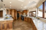 The kitchen offers high end appliances and everything you need to cook your favorite meals