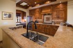 This custom kitchen is one you have to see to believe and is stocked for the gourmet chef.