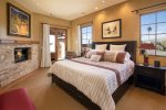 Enjoy the king size bed, flat screen tv and fireplace in the master bedroom