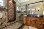 Stunning step in shower in master bath with tiles replicated from Hearst Castle