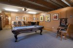 Game room is down stairs with a pool table that converts to a ping pong table and large tv