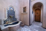 A fountain welcomes you to the front door of this hidden oasis