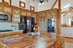 The kitchen offers high end appliances and ample space for multiple cooks