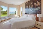 The master bedroom, upstairs, offers views of the bay and golf course