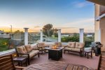 Relax on the deck with firepit and enjoy the sun setting over the bay
