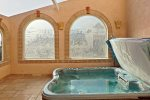 Enjoy the private hot tub in the enclosed atrium
