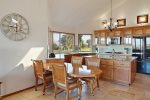 The kitchen features additional dining area for 4